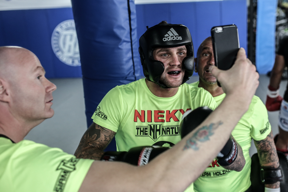 Glory champion Nieky Holzken takes a second out of training to Facetime with his baby.
