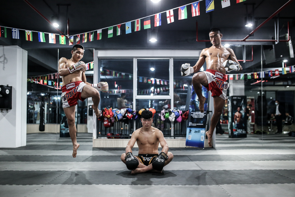 Three young prospects at their home gym in Chengdu, China.