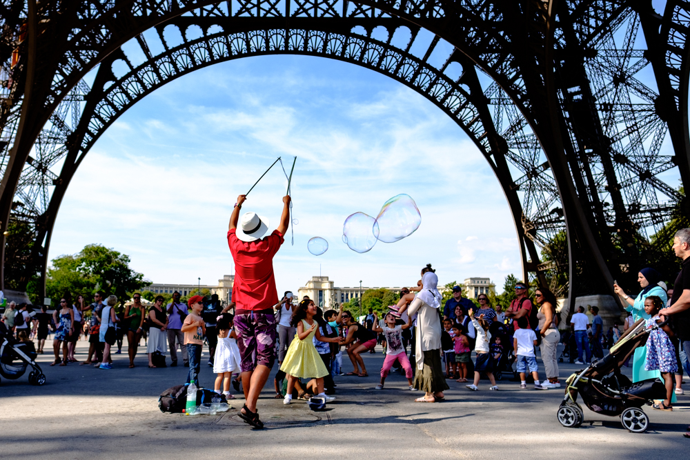 A street performer making bubbles for the kids in Paris, France.