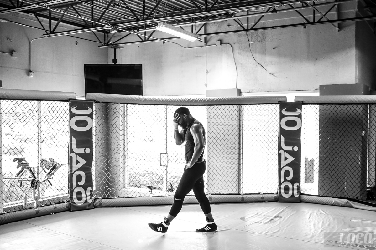 """While in camp for his fight with Glover Teixeira, """"Suga"""" Rashad Evans does a lap around the cage after practice."""