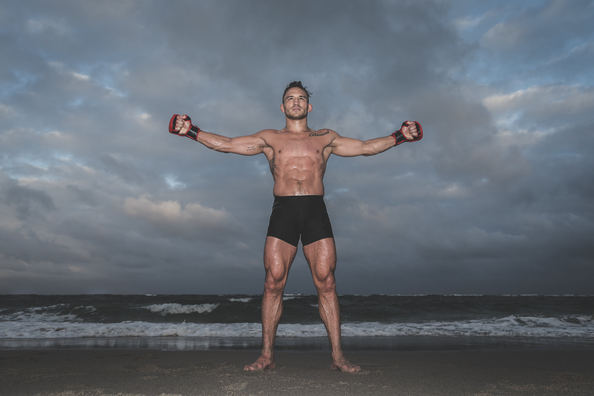 Bellator's Michael Chandler stands on the coast of Florida, post beach workout session with Henri Hooft.