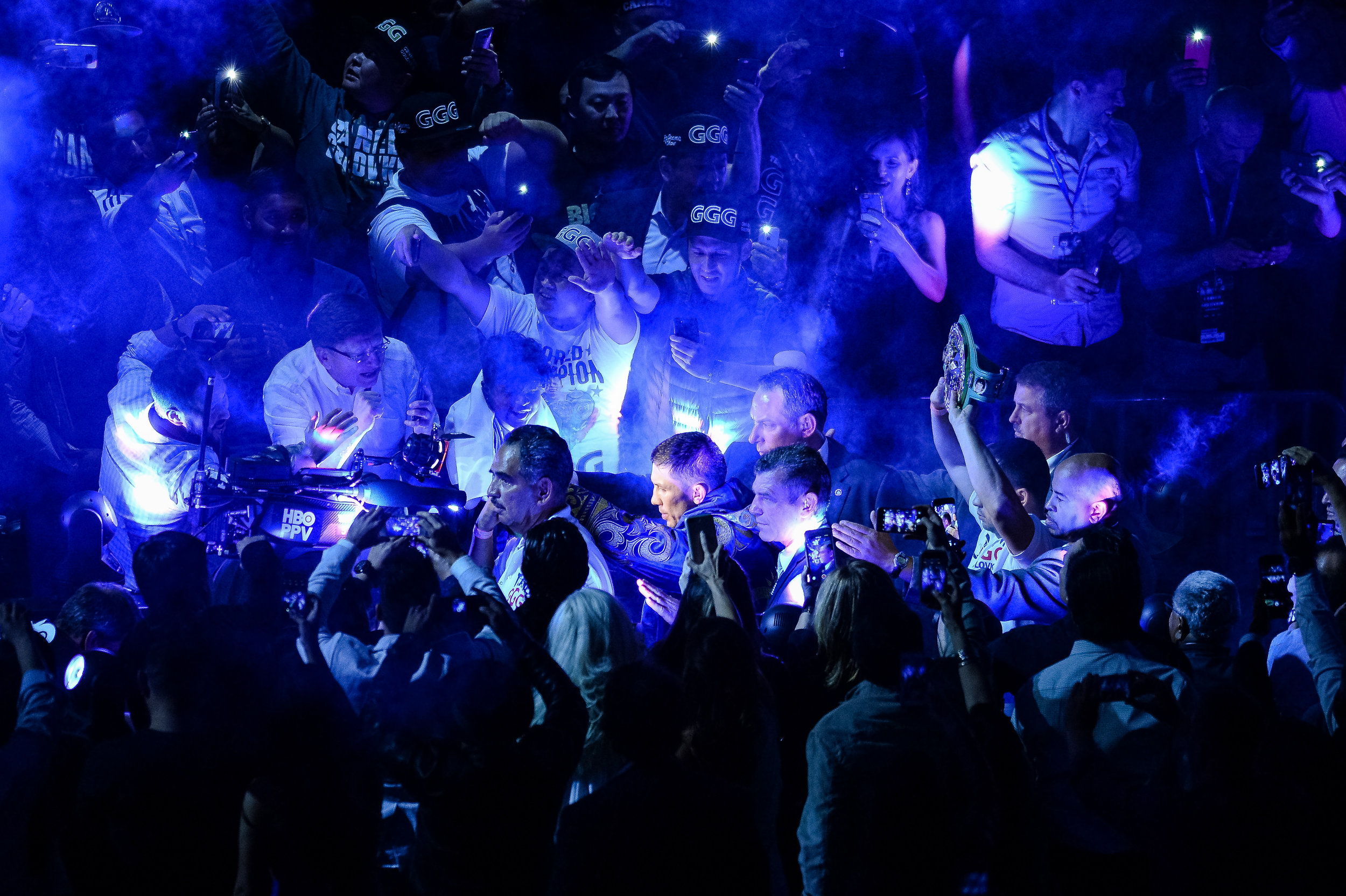 The entrance for Gennady Golovkin for his fight with Canelo Alvarez. I love the fans with their GGG hats, the phones recording the entrance, and how the light makes it look like he is parting a sea of fans.