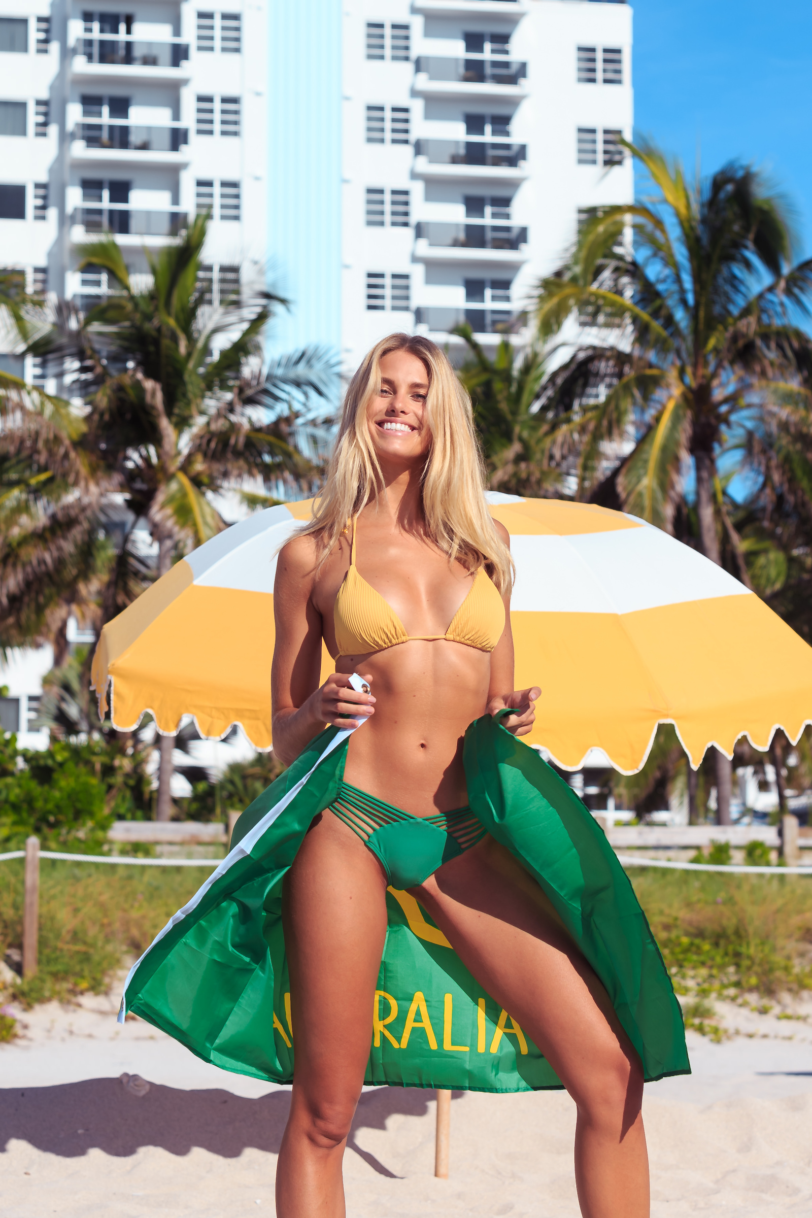 Australian model Natalie Roser showing love to her home while on the beach in Miami, FL.