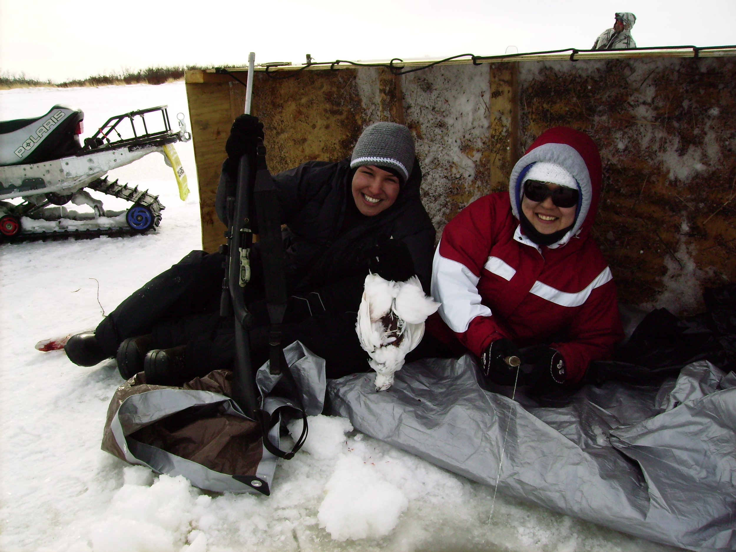 Friends do some Ice fishing and bird hunting along the Eek River.