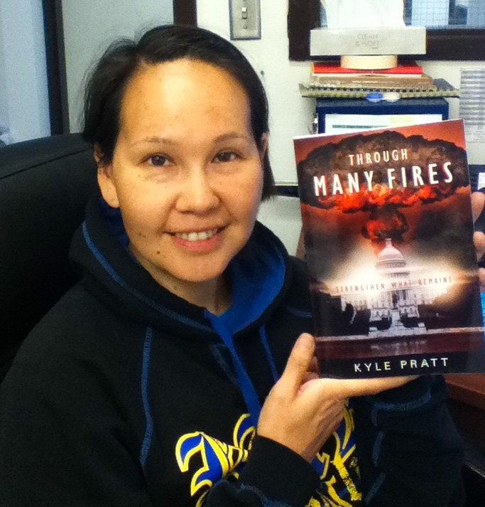 Loni Hoover with the first copy of Through Many Fires