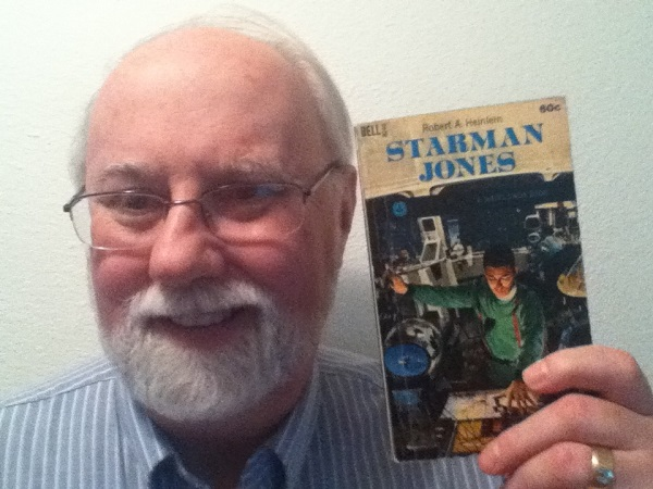 Kyle Pratt with the first book he ever read, Starman Jones by Robert A. Heinlein