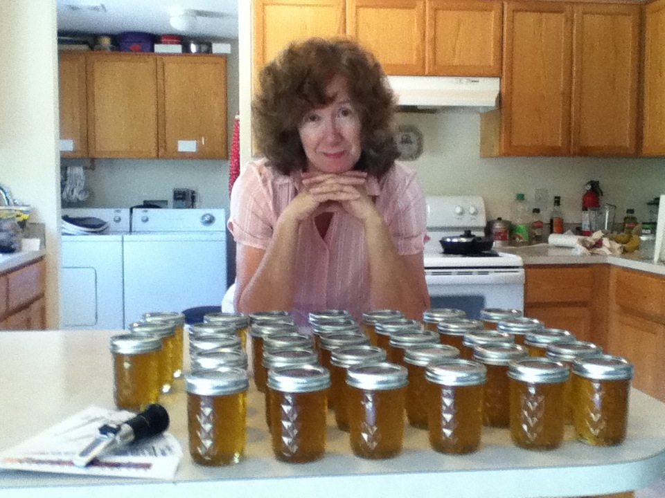 Lorraine Pratt looks over twenty pounds of honey.