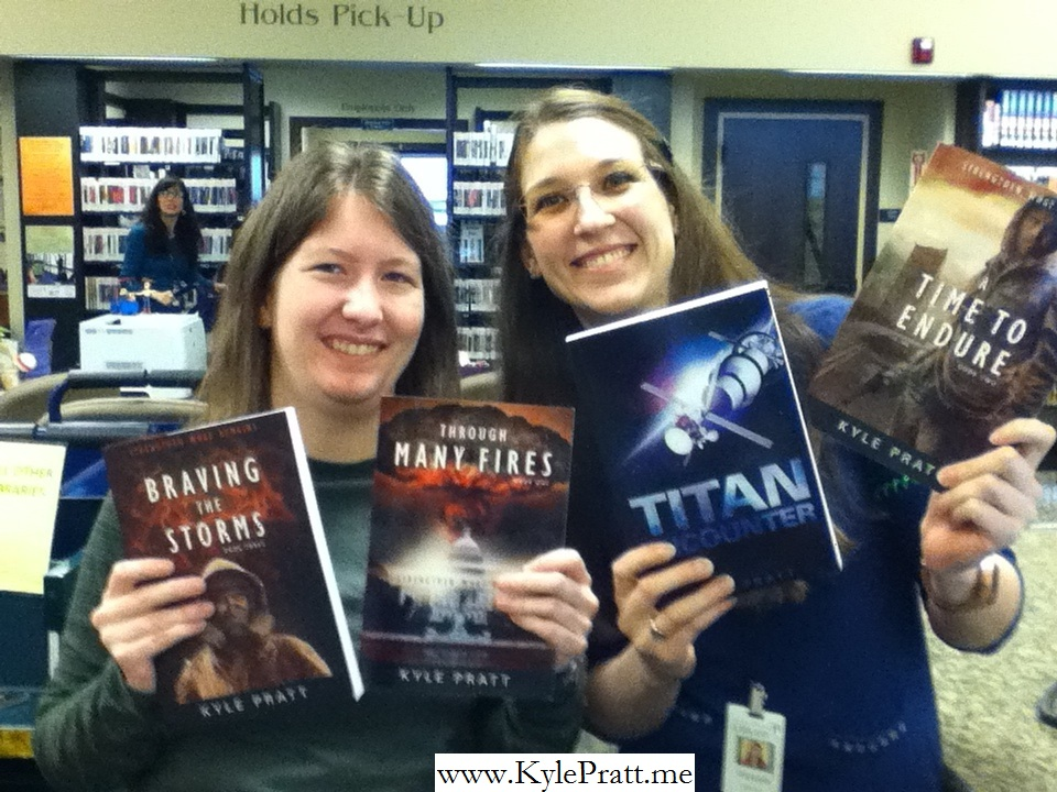 Amy and Victoria with  Braving the Storms, Through Many Fires, Titan Encounter  and  A Time to Endure  from the Chehalis, Washington Library.