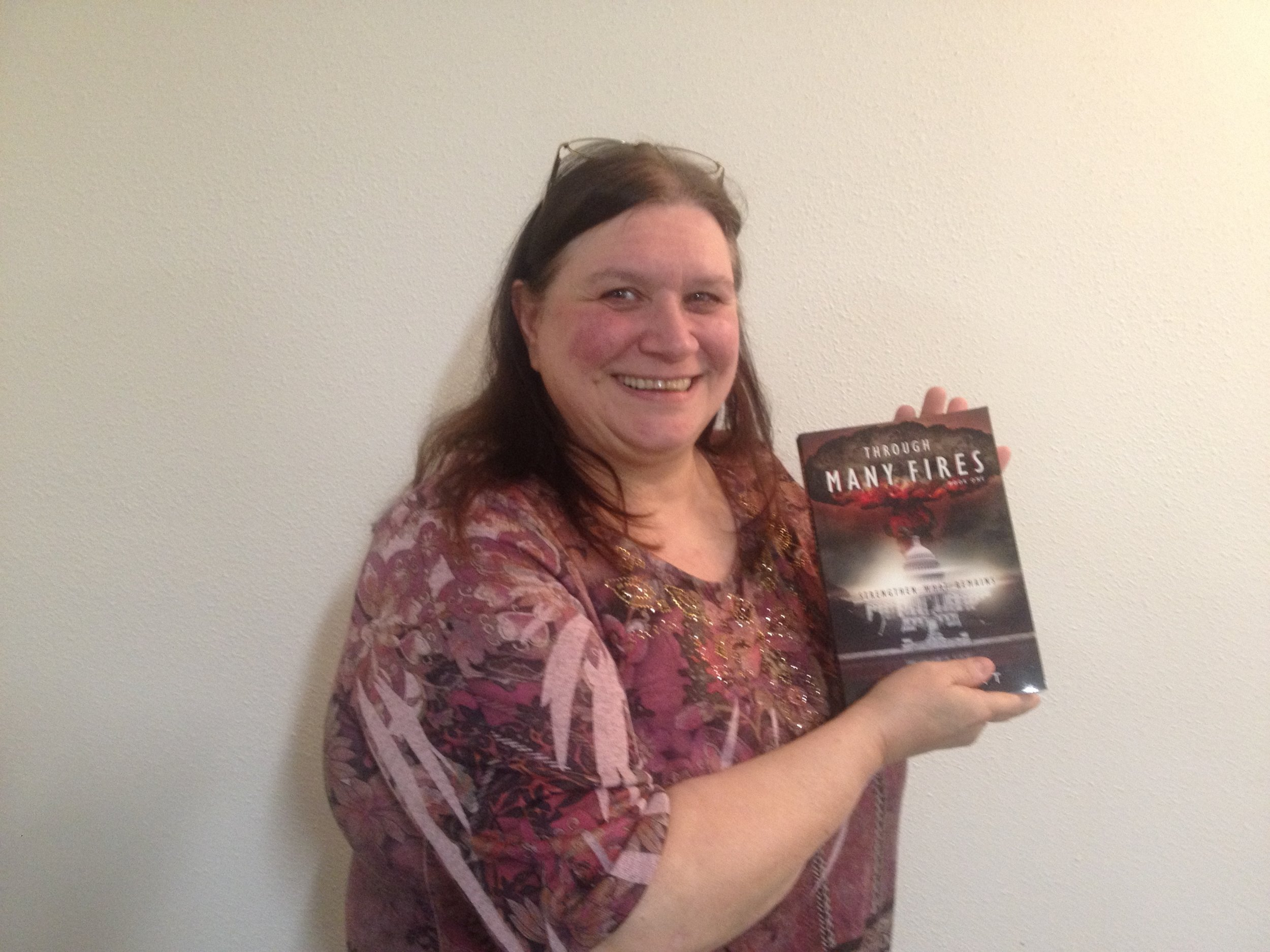 Debbie from Centralia, Washington State, with a copy of  Through Many Fires.