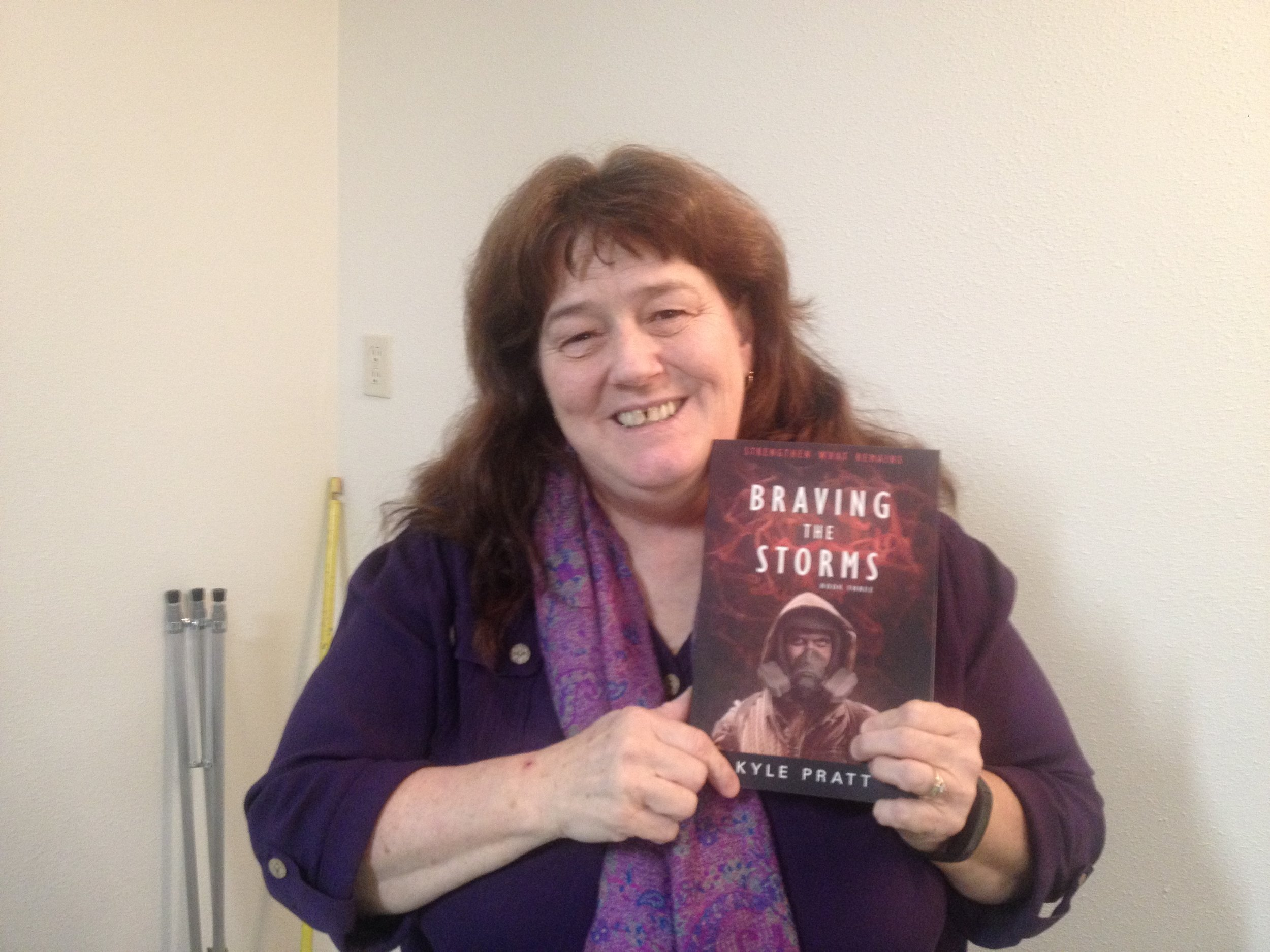 Julie from Toledo, Washington State, with a copy of  Braving the Storms . She told me that she has already read  Through Many Fires  and  A Time to Endure .