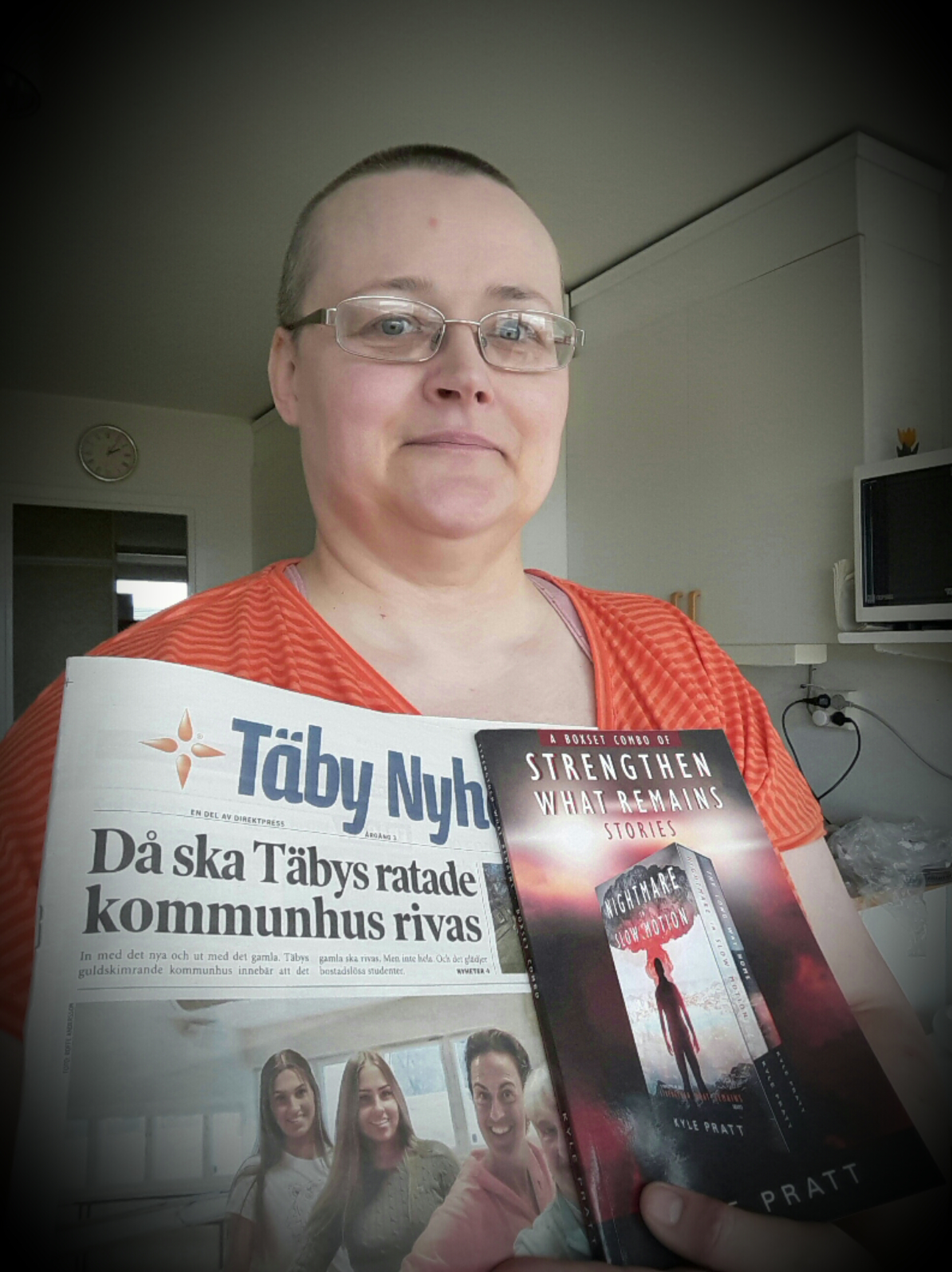 Karina from Sweden holds a copy of the combo book with  Nightmare in Slow Motion  and  The Long Way Home .
