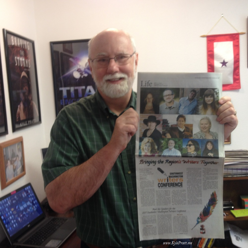 Kyle with Newspaper (small).jpg
