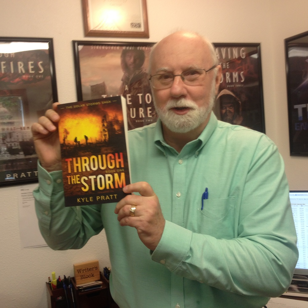 Kyle with a copy of  Through the Storm