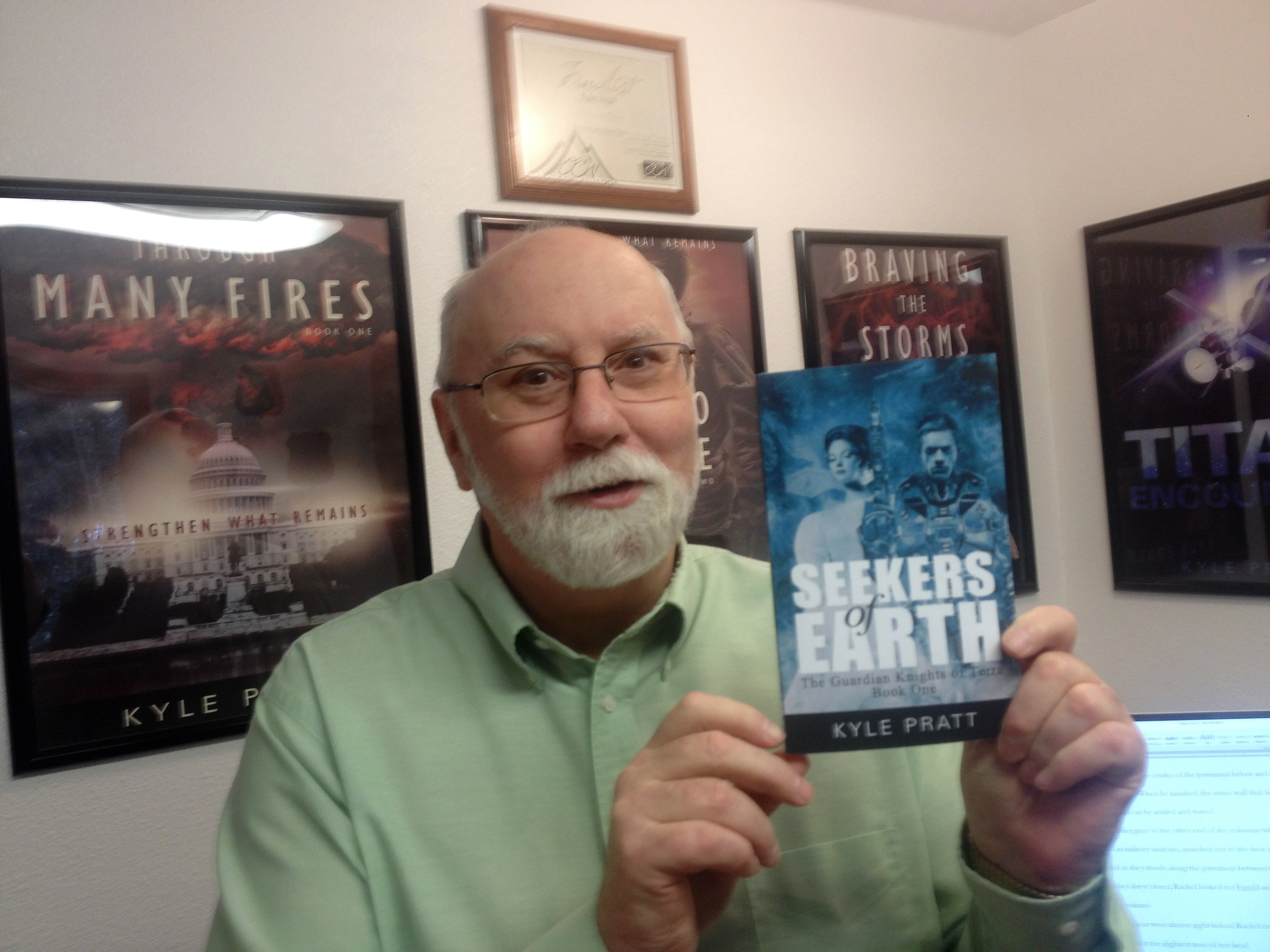 Kyle with a copy of Seekers of Earth