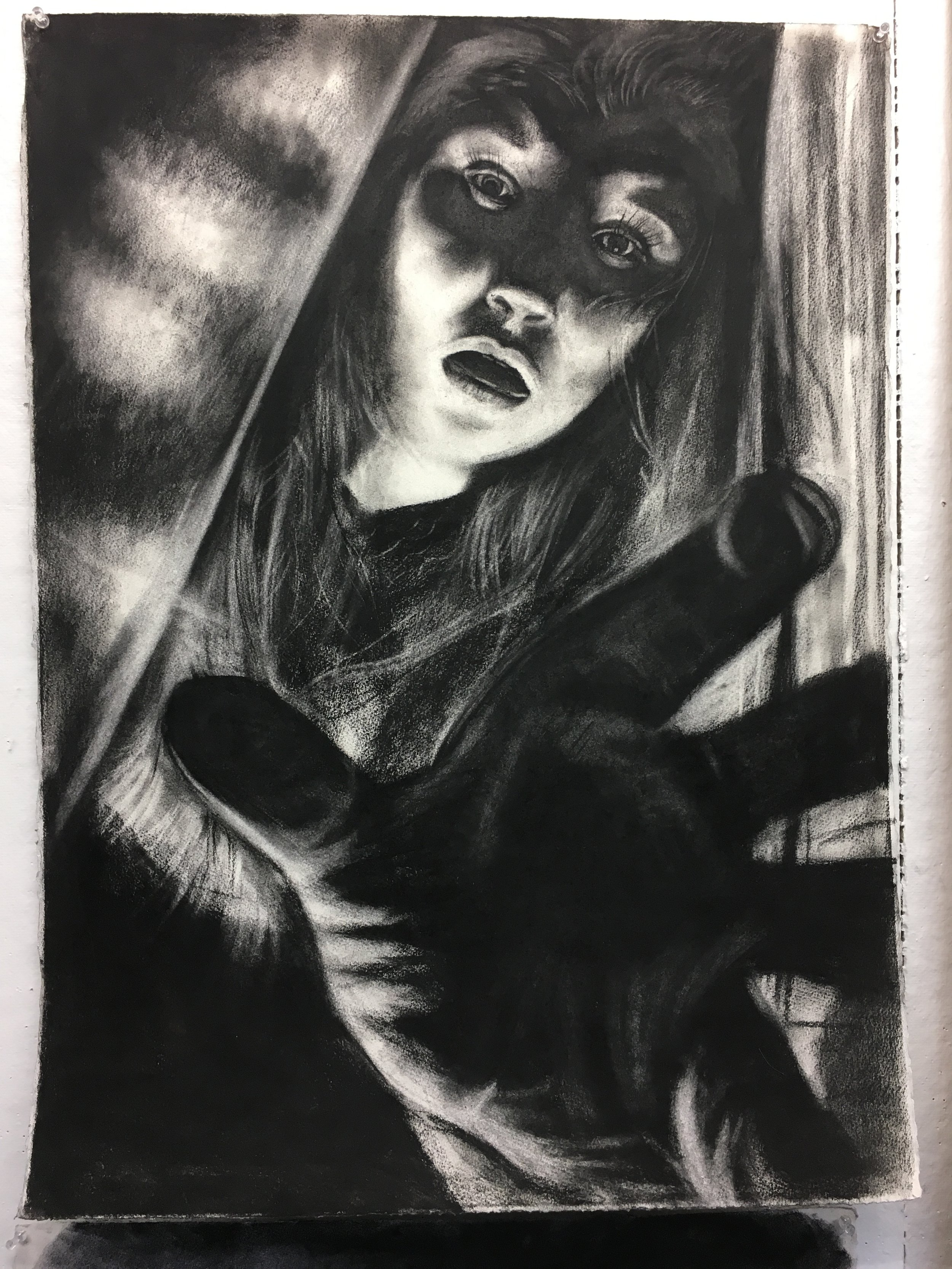Large scale self-portrait in charcoal