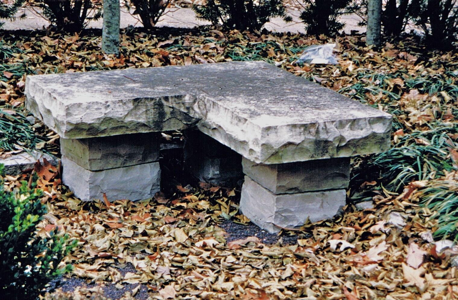 Limestone Corner Bench in a Sunken Garden