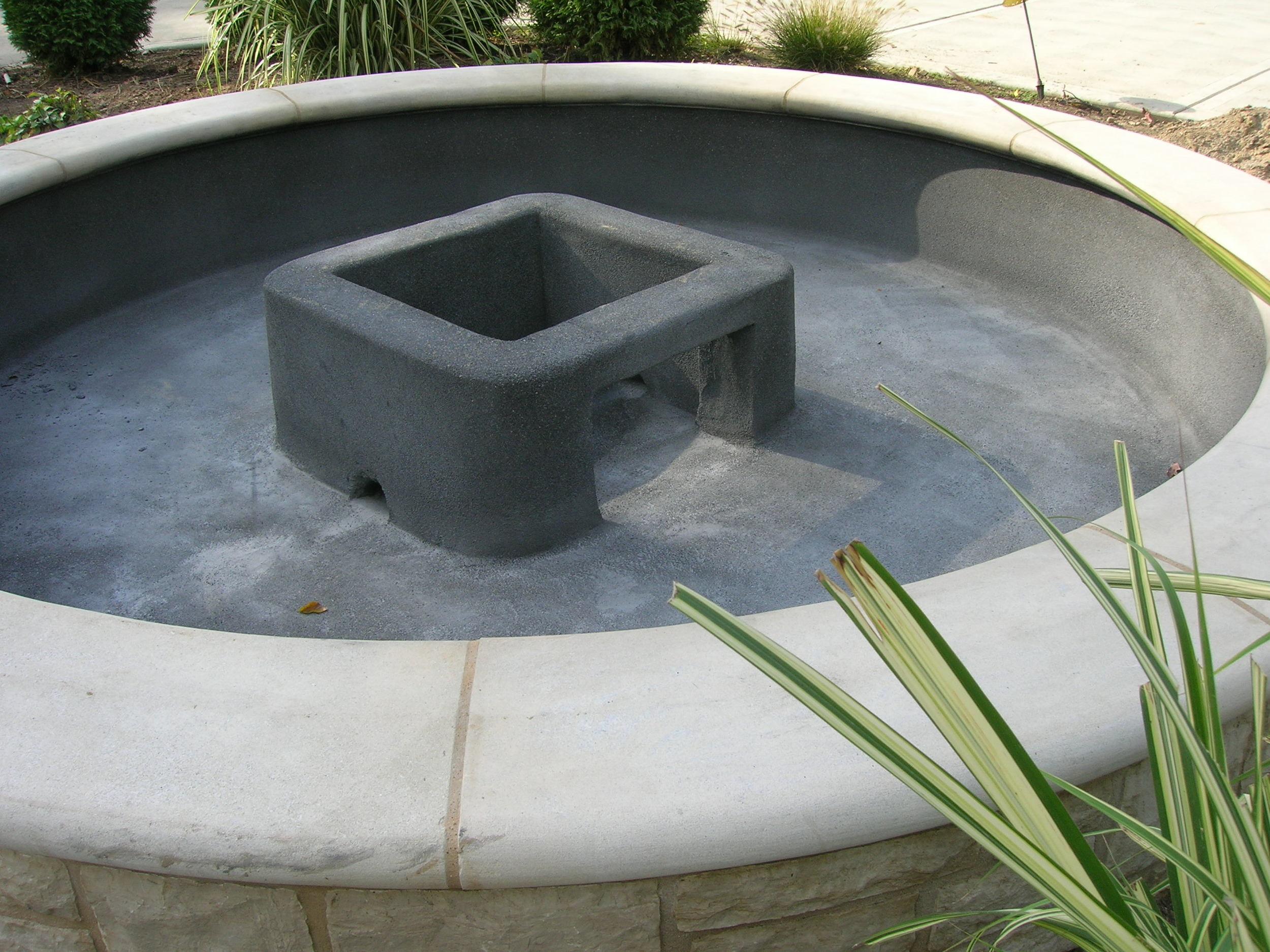 Concrete Fountain Base in a Fountain Pool