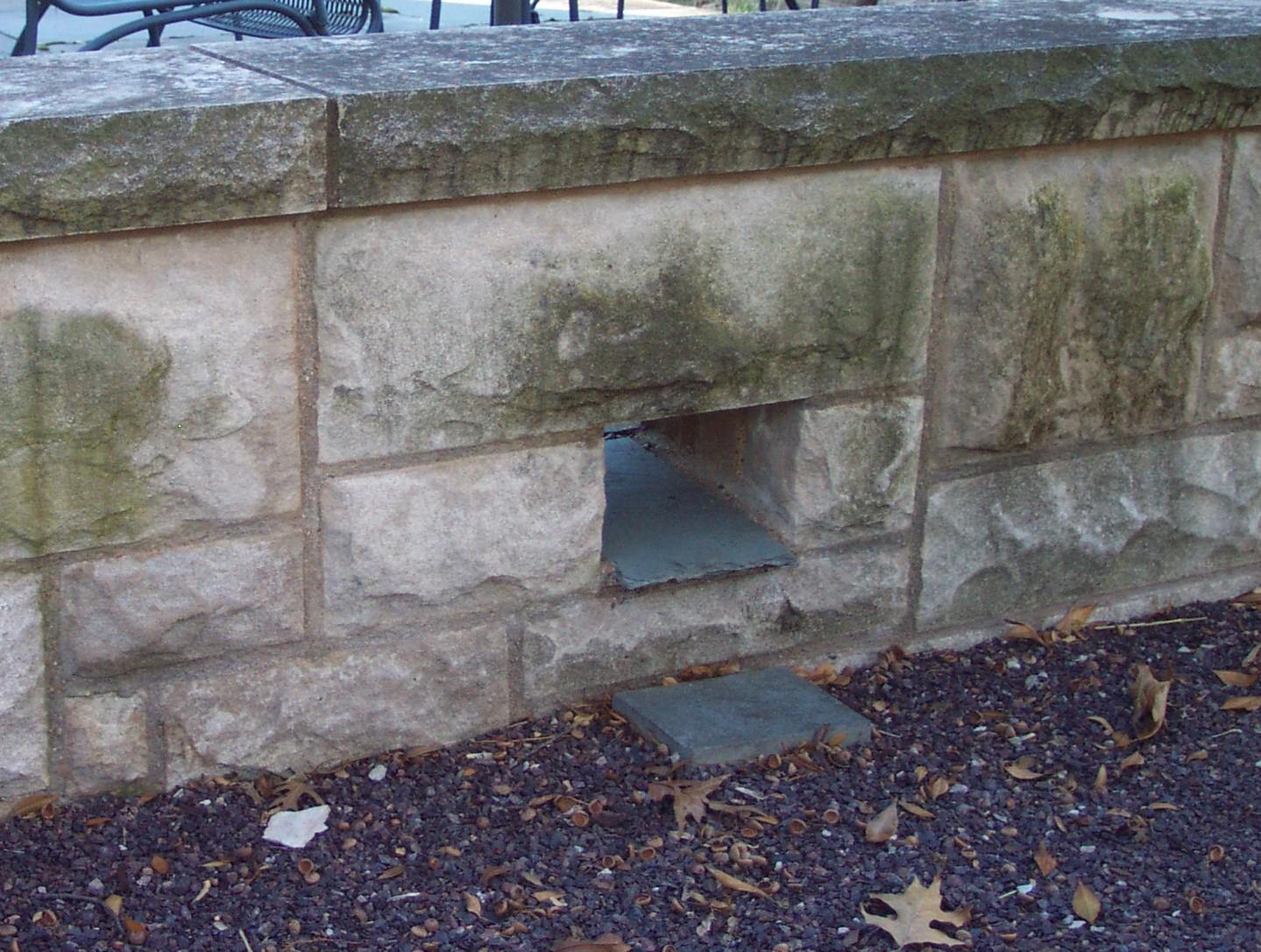 Slate Scupper Through a Limestone Sitting Wall