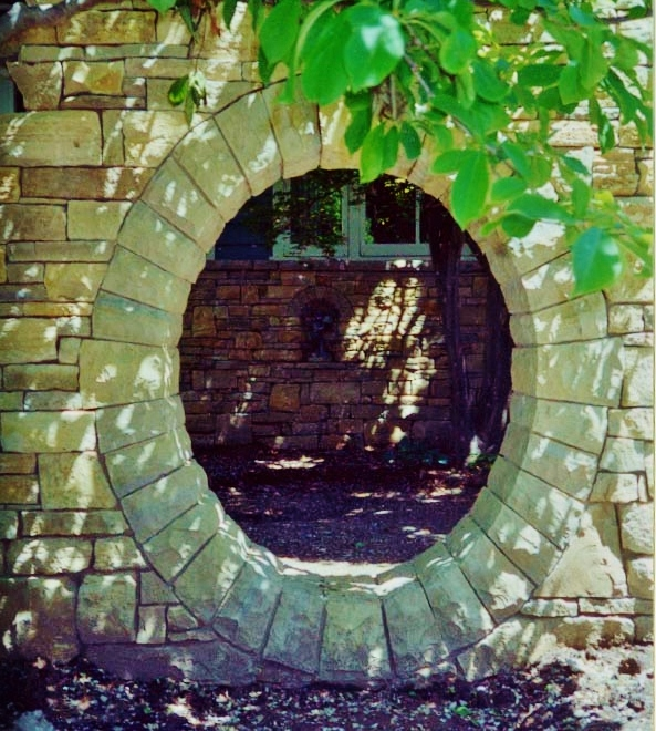 This stone moon gate is the entrance to a secret garden.  Stone Works  Lee Lindsey, St. Louis, MO