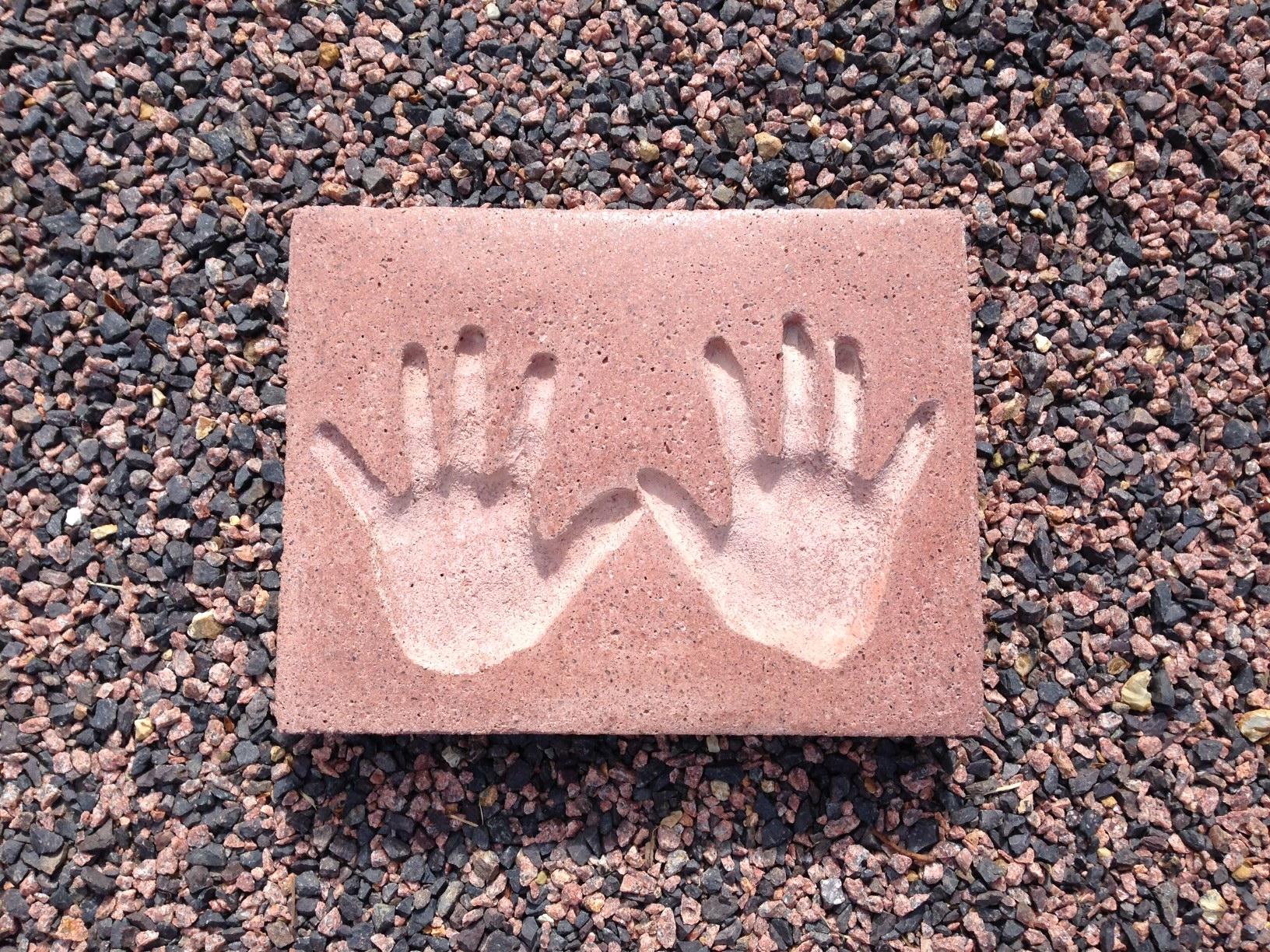 Handprints in Red Granite