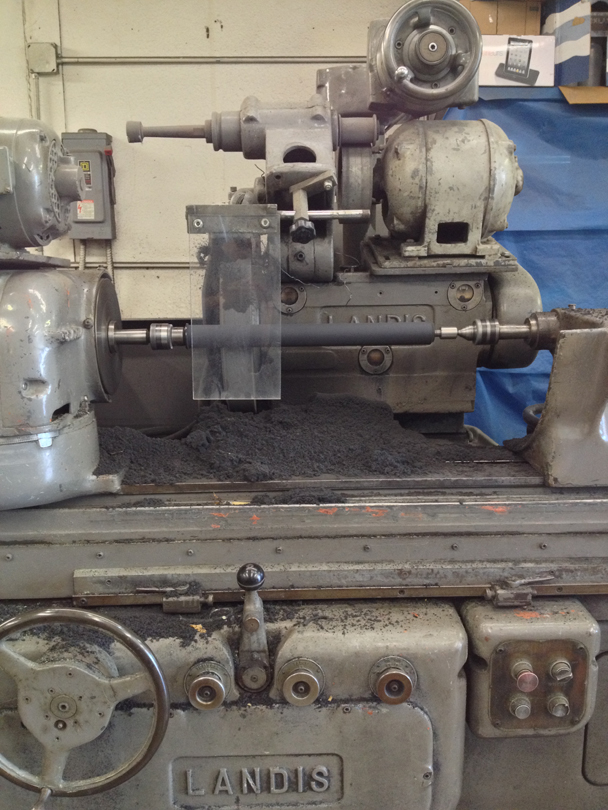 The machine that grinds down the rubber to the precise 1000th of an inch.