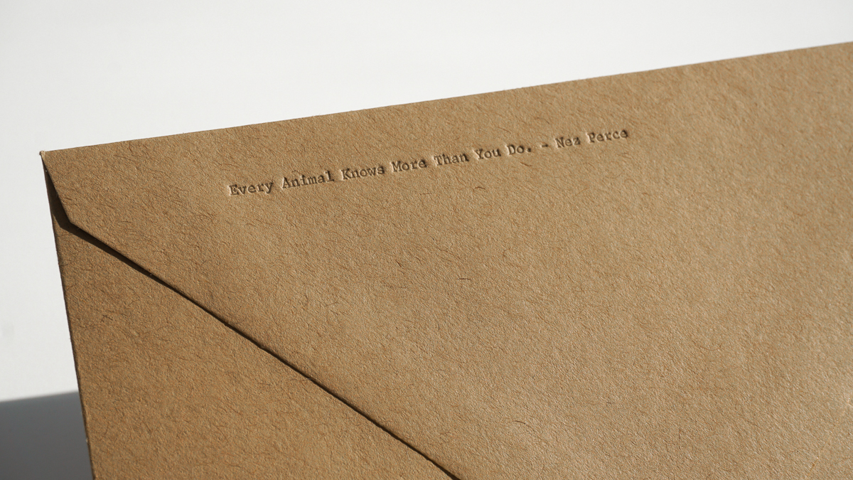 Pressed quote on envelope flap