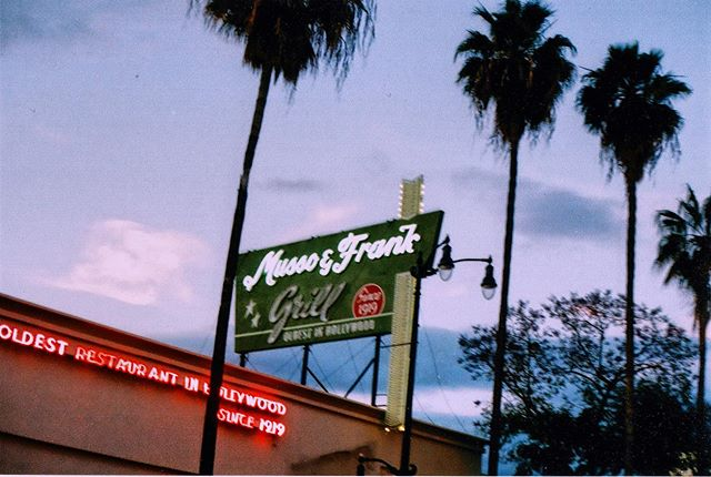 Musso🍸 | Photo  taken outside @mussoandfrankgrill in Hollywood, Los Angeles, CA | Shot on Holga camera using Fuji Superia #35mm film  #losangeles #desert #photofilmy #california #palms #shootfilm #film #filmmaker #filmphotography #wanderlust #hollywood #holga #light #noir #girlgaze #photography #filmcamera #filmisnotdead #streetphotography #blue #color #womeninfilm #LA #girlsinfilm #shootitwithfilm #onceuponatimeinhollywood #hollywood #shootitwithfilm #analogphotography #fisheyelemag