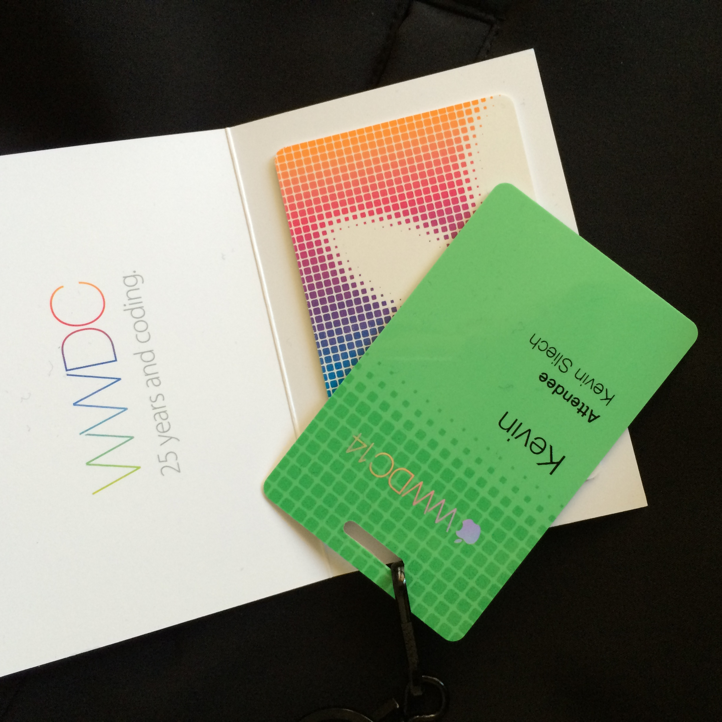 WWDC badge and extremely generous $25 iTunes gift certificate (K. Sliech, iPhone 5S)