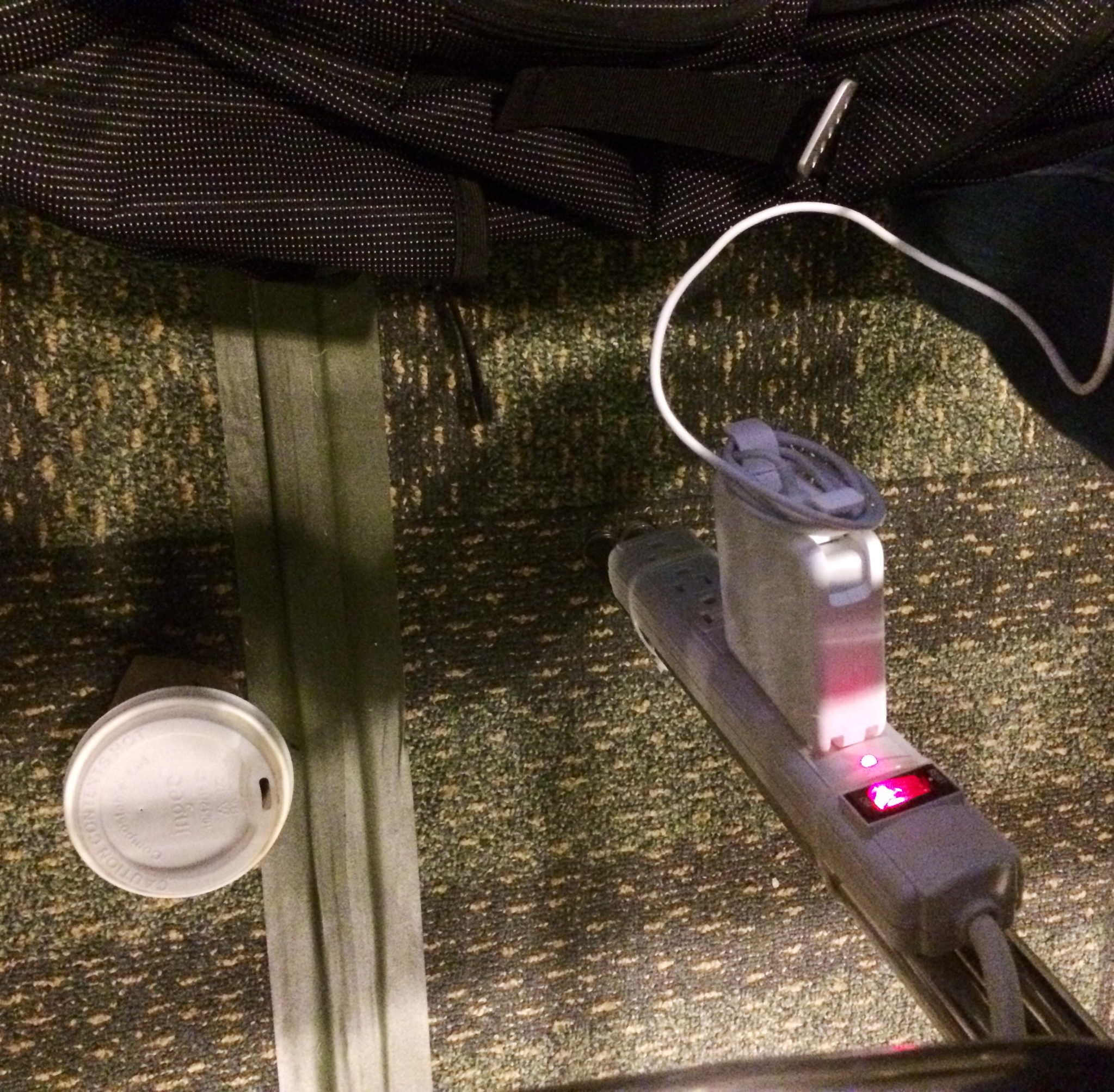 Under-chair power and coffee storage! I found this incredibly exciting. (K. Sliech, iPhone 5S)