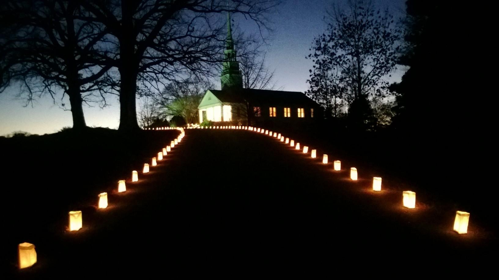 Luminaries light the way to  Chrismas  Service