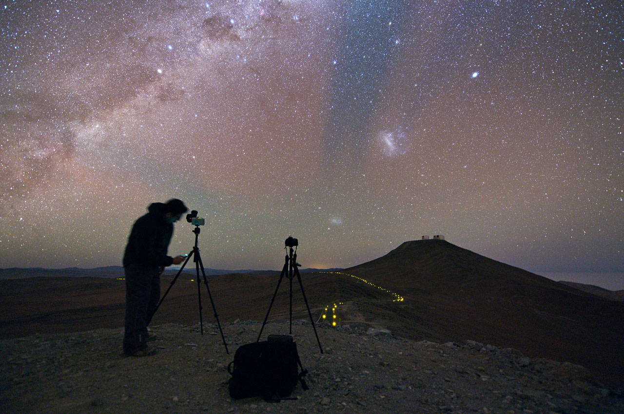 The Small and Large Magellanic clouds soar high above Cerro Paranal and the VLT. Credit: ESO/B. Tafreshi.