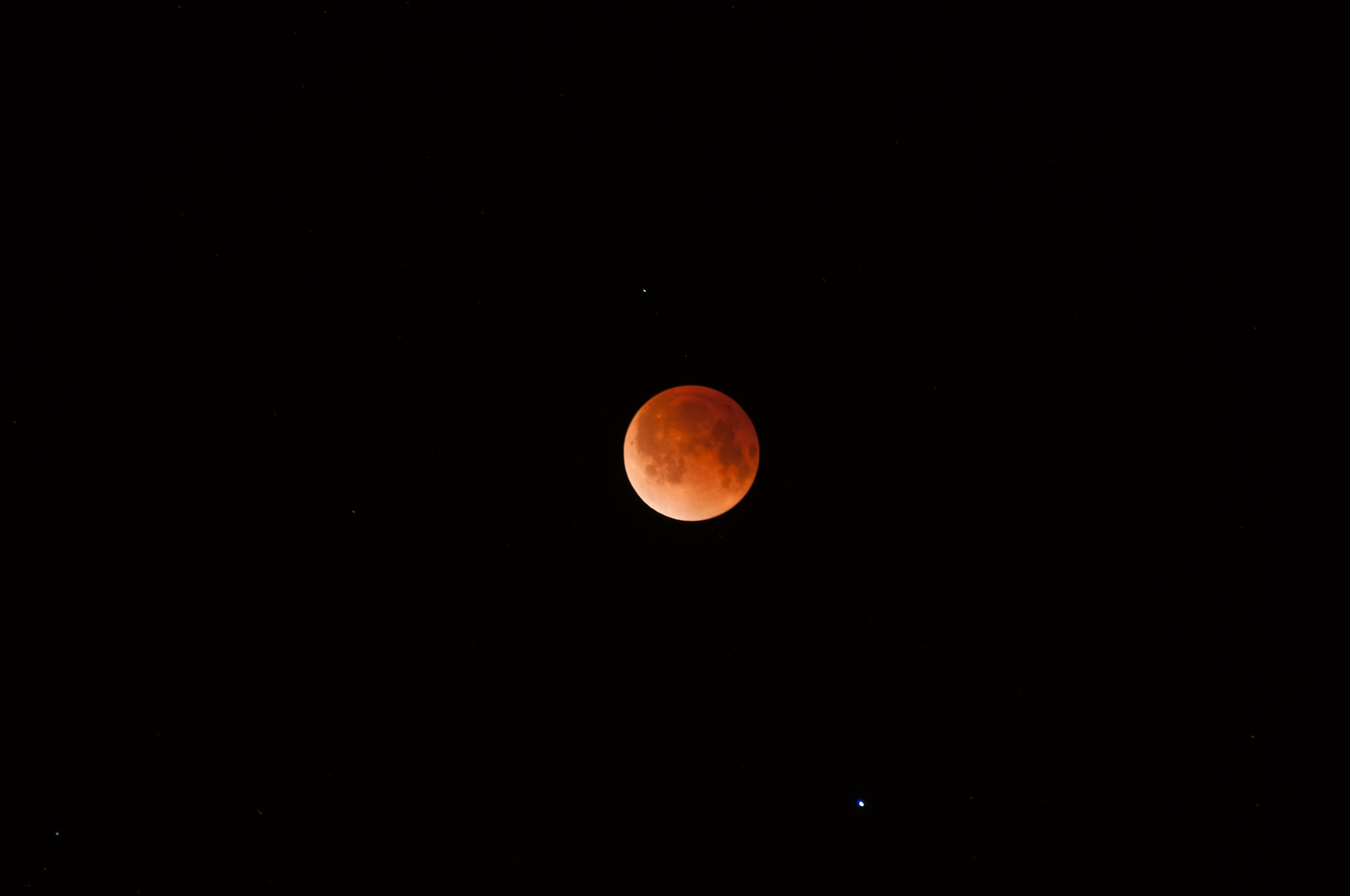 Moon in total eclipse with Spica beneath