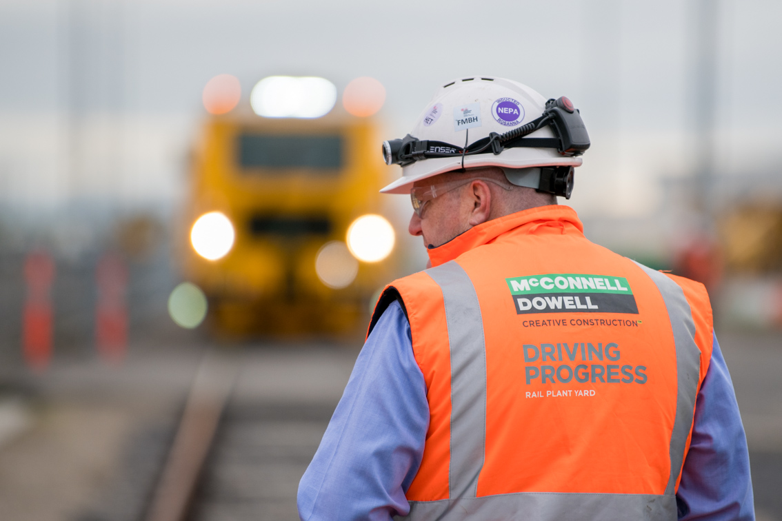 Client: McConnell Dowell - Project: Upgrade of still image library for McConnell DowellOur assignment was to create general commercial imagery for our client McConnell Dowell at their new rail yard in Sunshine. We were met with very gloomy skies which at first never seems ideal. However these kind of conditions allow us to really bring out the colour on site, be able to shoot from any angle and avoid situations where contrast of light gets in our way.
