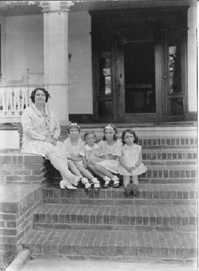 Henriette Bassett with her daughters on the porch at Pineola