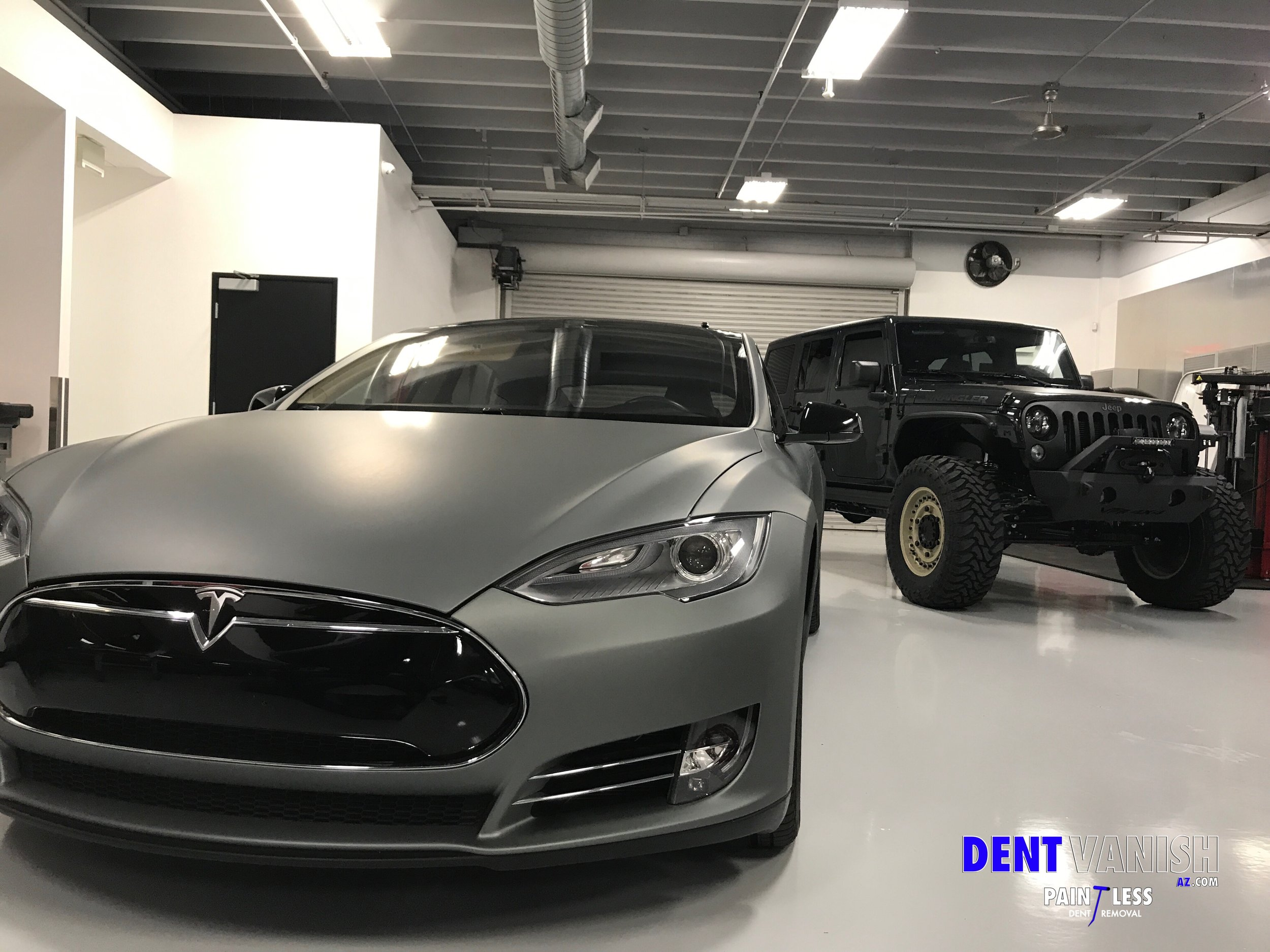 Tesla and Lifted Jeep