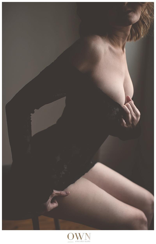 atlanta boudoir redhead woman black lace lingerie stool