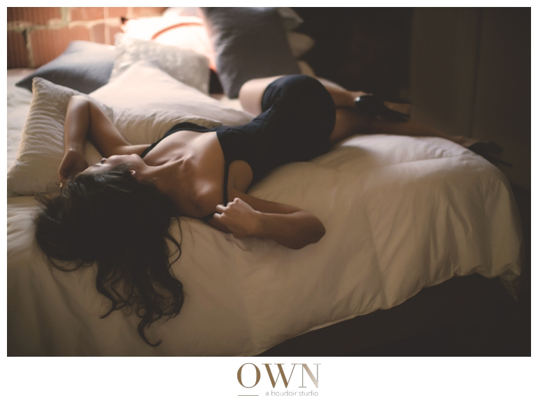 brunette bodysuit on bed atlanta georgia boudoir