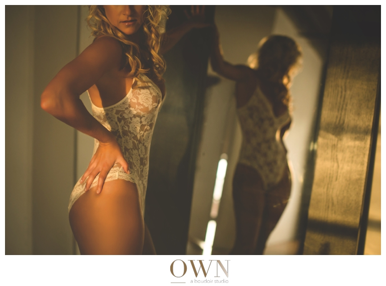 lace lingerie sunset mirror boudoir session with photographer in atlanta