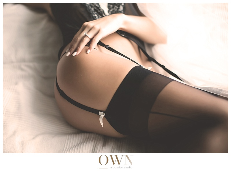woman on a bed boudoir photography thigh highs