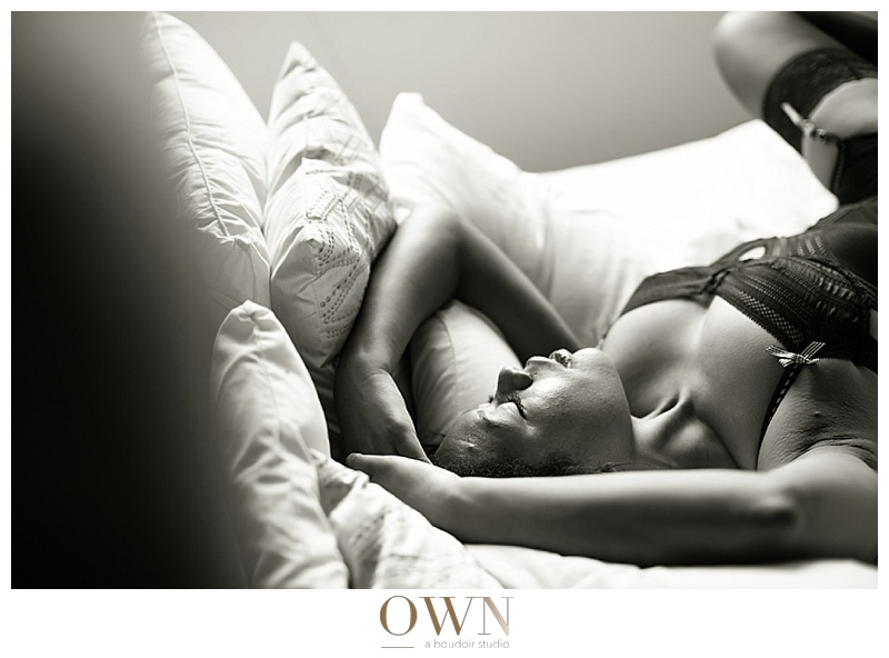 woman on bed black and white own boudoir photography atlanta
