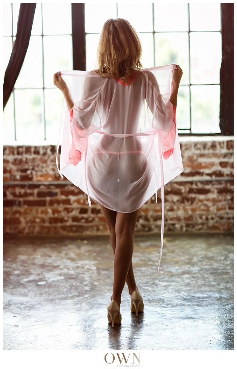 beautiful woman in atlanta own boudoir photgraphy pink robe