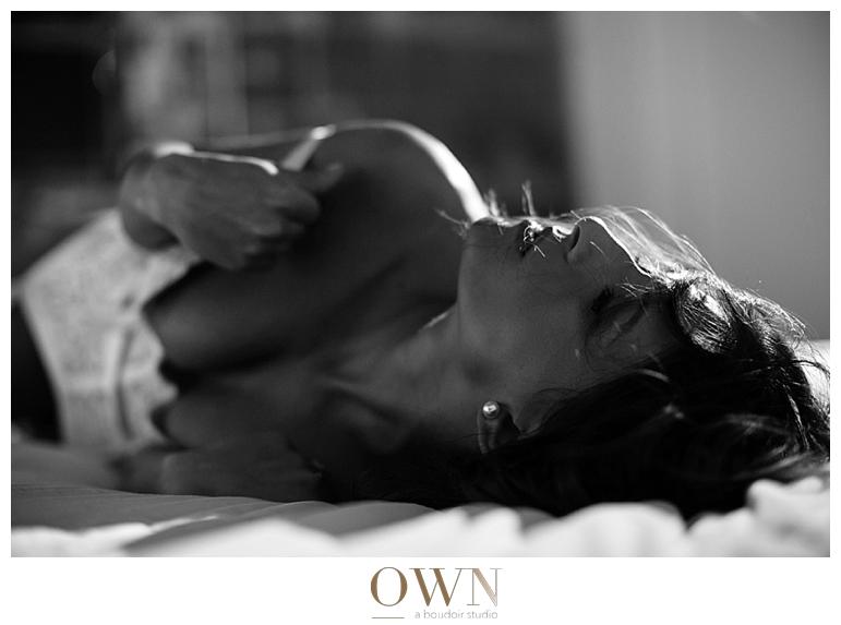 woman in bed own boudoir atlanta boudoir photographer