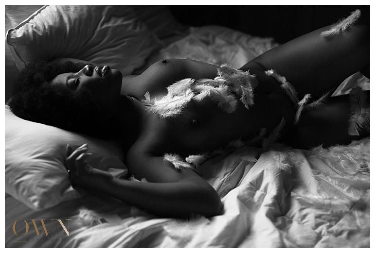 own boudoir, atlanta boudoir photographer, feathers, slumber party boudoir, pillow boudoir, african american boudoir, boudoir photographer atlanta, atlanta boudoir session