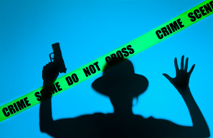 Figure Behind Crime Scene Tape (image licensed by Colleen Collins)