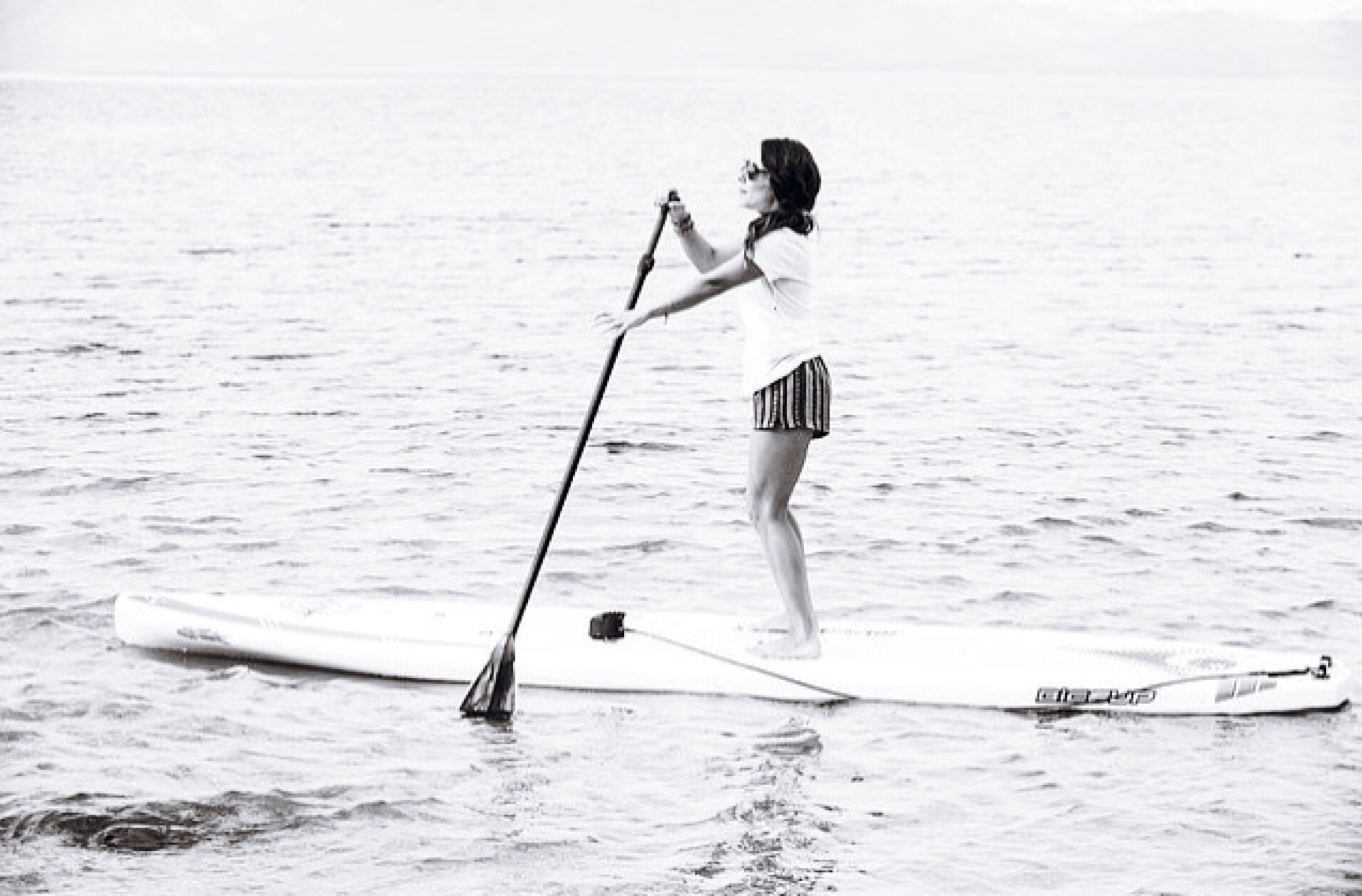 + Christi paddle boarding to our next location.