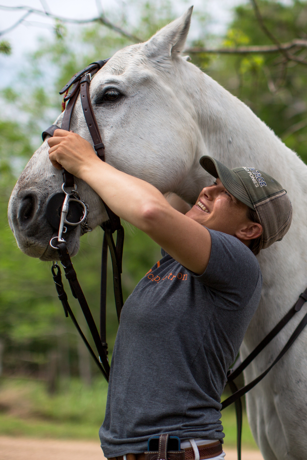 "Hudspeth puts a bridle on her horse named ""Blueduck"", who she trained herself and has a personal connection with. While her sponsor owns most of the horses she rides, this is one horse out of a couple that she owns."