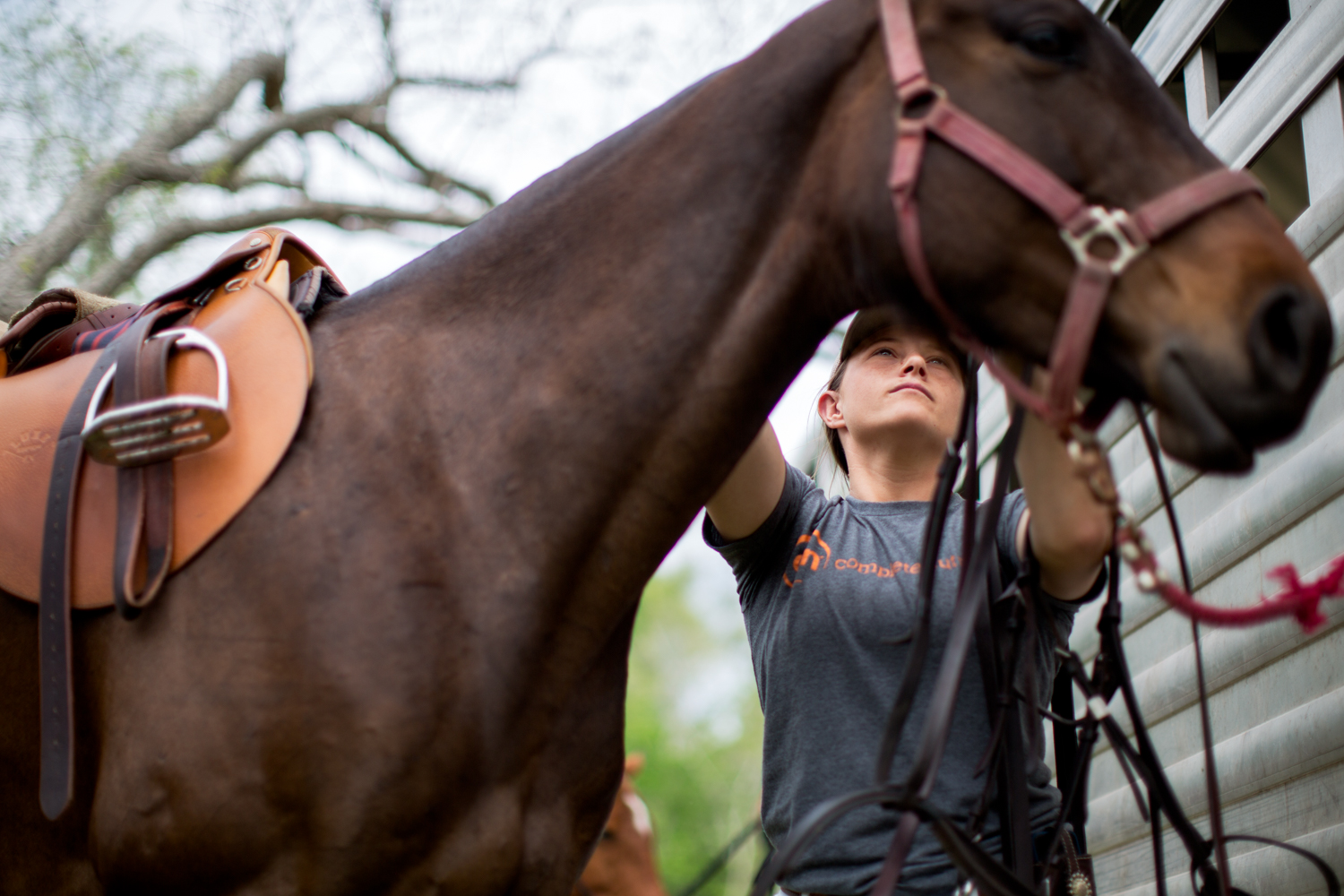 Hudspeth tacks up her horses before a charity game in McFaddin, Texas. Hudsepth and her groom have to prepare anywhere from 8-12 horses per game for herself and her sponsor. A polo game can consist of 4-6 chukkers and players switch horses between every chukker.