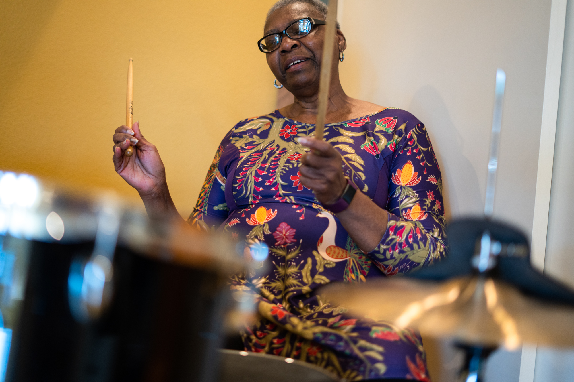 Gwen Davis plays the drums during her therapy session to work on pattern switching. Music therapy can involve a range of activities, from actual creation of music or beats to rhythmic movement to music playing in the background.