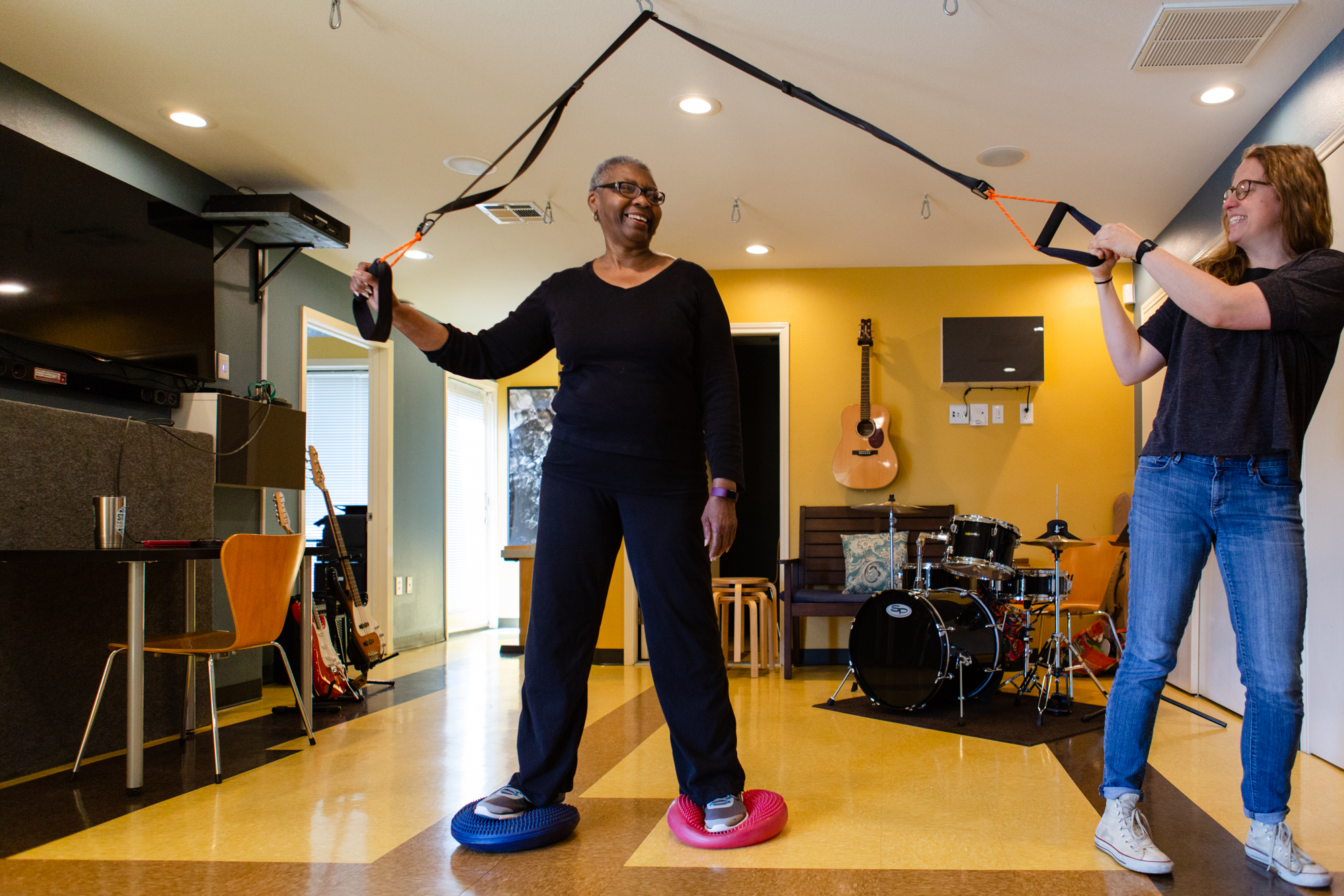 Davis works on a balance exercise with her music therapist Emily Morris. Davis says she likes to be challenged in these therapy sessions and Morris pushes her while making their sessions fun.