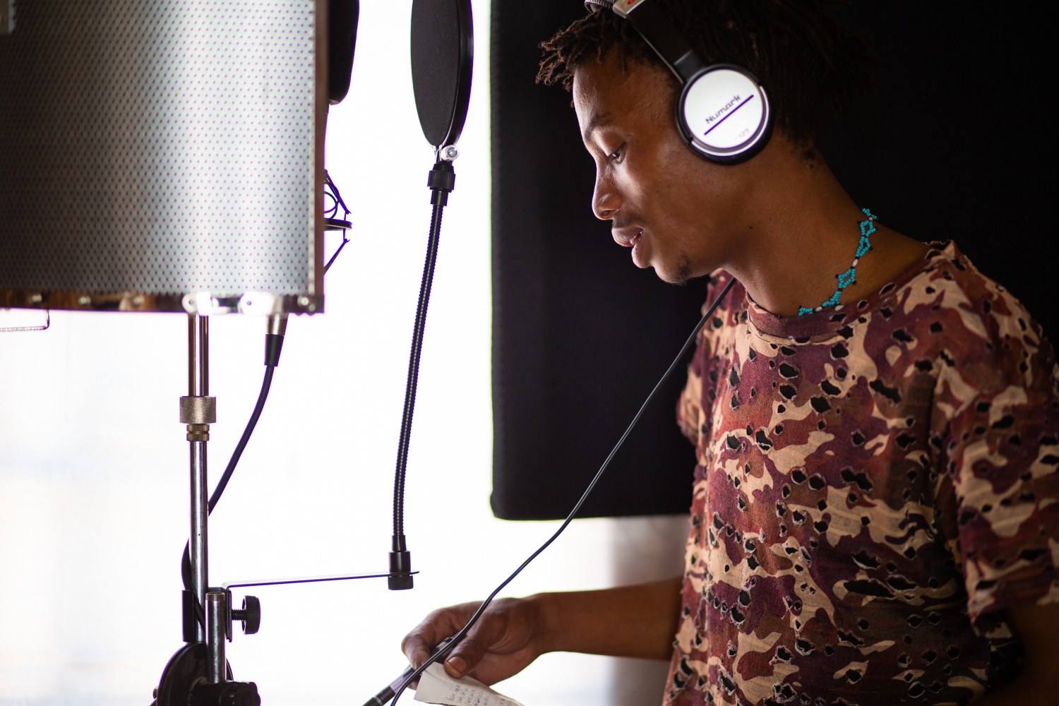Alphynho prepares to record a new song during a recording session in Ghanzi. He sings in Naro, the native language of the San in the region west of the Kalahari, and uses many traditional musical elements. He hopes to preserve and celebrate his culture and language through his music.